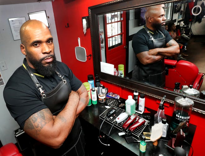 Dwone Hicks, a former NFL and MTSU football player, now is studying to be a barber in addition to teaching special education at Blackman High School.