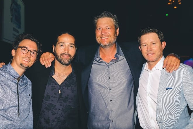 "Matt Dragstrem, left, Josh Thompson, Blake Shelton and Ben Hayslip celebrate backstage after ""I'll Name the Dogs"" was named Song of the Year at the Nashville Songwriter Awards."