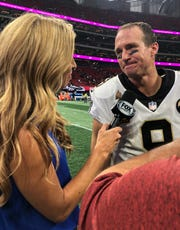 Former News 2 and ESPN anchor Sara Walsh, left, interviews New Orleans quarterback Drew Brees after the Saints' 43-37 overtime win Sunday over Atlanta.