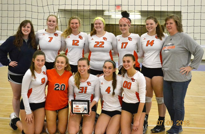 The Dickson County High School volleyball team following their tournament championship win over in the Rocky Top Classic.
