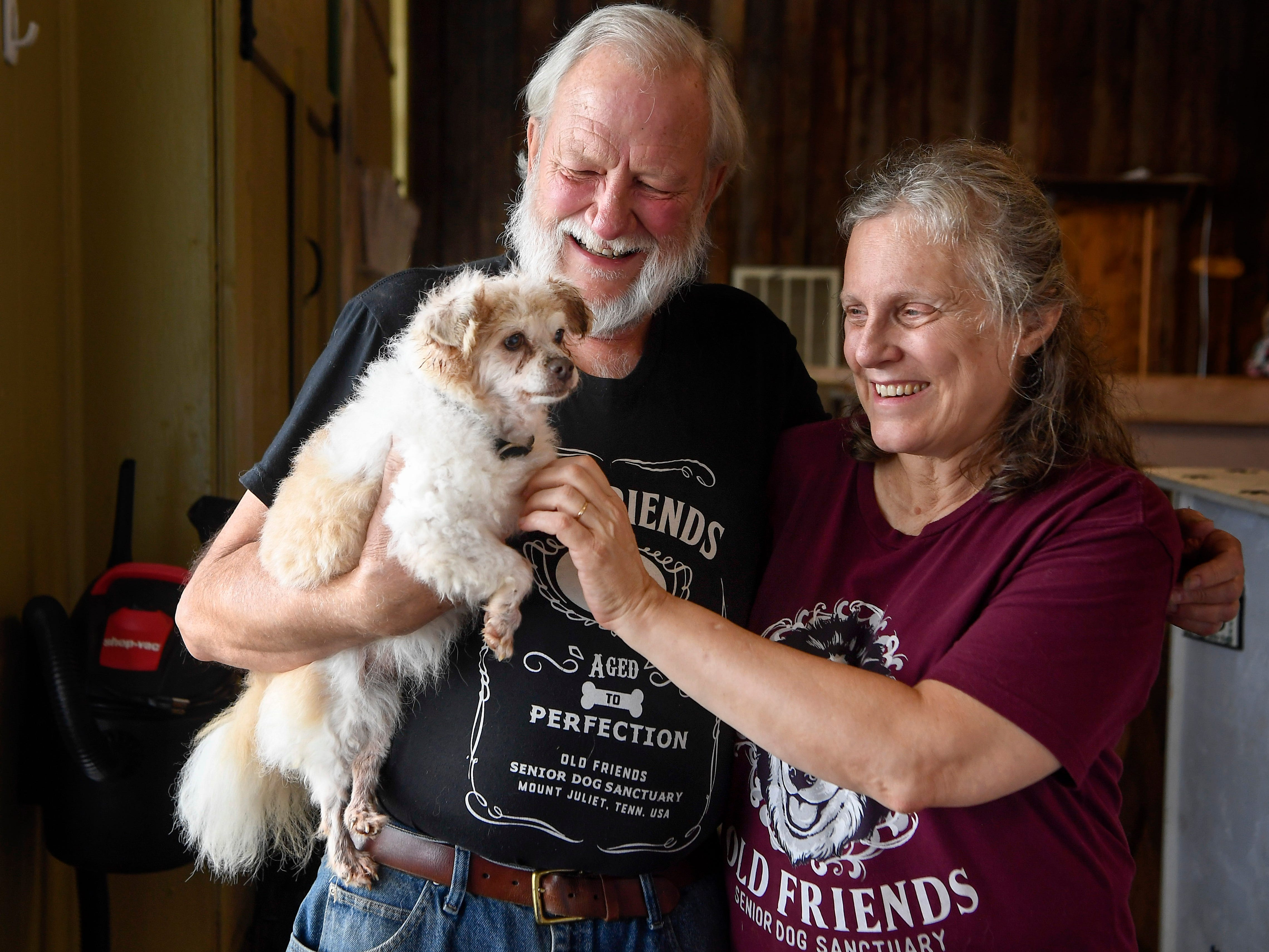 Michael and Zina Goodin, the founders of Old Friends Senior Dog Sanctuary in Mount Juliet, pose with Tigger, Tenn., Monday, Sept. 24, 2018.