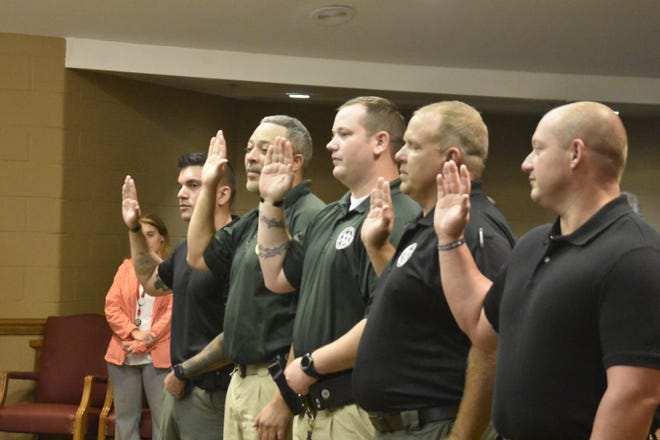 New Cheatham County School Resource Officers are sworn in on Monday, Sept. 24 in the General Sessions Courtroom in Ashland City.