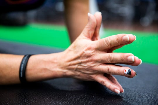 Alice Skaff, 54, has mountains and a red heart, which represent Mt. Kilimanjaro and her nonprofit Haven of Hope International, respectively, painted on her fingernail, as seen while she trains at Around the Clock Fitness in Fort Myers on Sunday, Sept. 23, 2018. Skaff is training to climb Mt. Kilimanjaro from October 3rd to the 9th to raise money for her nonprofit that helps raise the quality of orphanages in developing countries around the world.