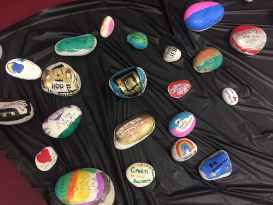 Some of the many rocks with kindness messages created by LCA students for placement around the community.