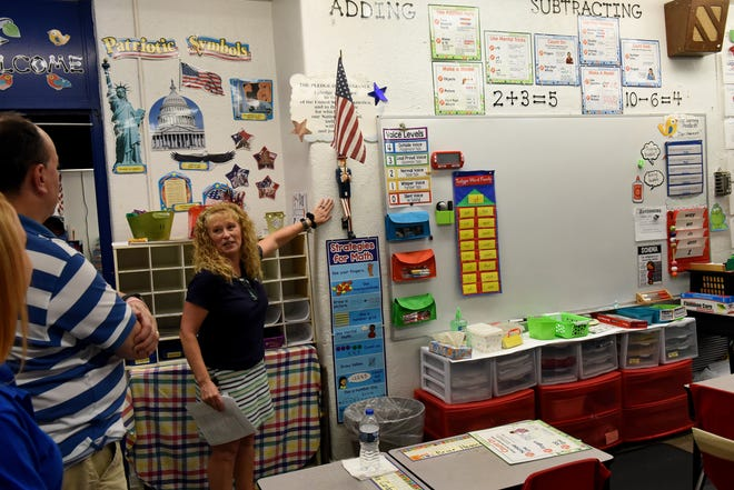 Hebron Elementary School teacher Amy McCartney gives a tour of her classroom on Wednesday, Sept. 12, 2018. While McCartney has done a lot to decorate and improve her classroom including painting projects, the room only has three outlets. Teachers and staff at Hebron Elementary School gave tours of the building to share it's history as well as the problems they face in the space. The district will head to the ballet in November to ask voters to approve a bond for a new elementary school.