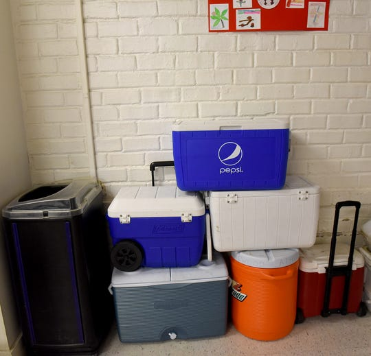 Coolers stack near the cafeteria of Hebron Elementary School. The coolers were filled with water and ice to keep students and staff cool during high heat early in the school year. Teachers and staff at Hebron Elementary School gave tours of the building to share it's history as well as the problems they face in the space. The district will head to the ballet in November to ask voters to approve a bond for a new elementary school.