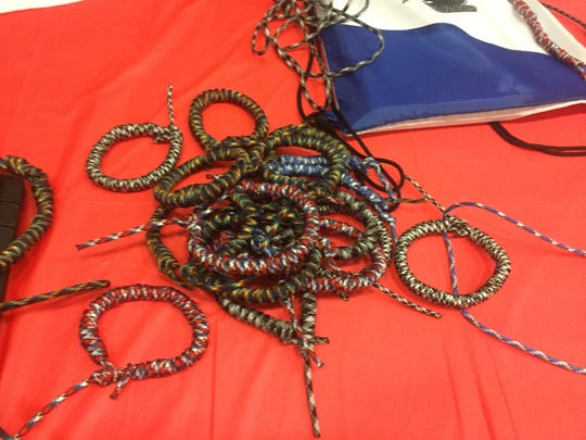 "LCA middle school students were also busy making these paracord survival bracelets for ""Operation Gratitude."""