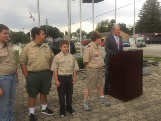 Local Scouts listen as Mayor Mike Compton speaks of the thousands still missing or who were held prisoner during American's various military engagements.