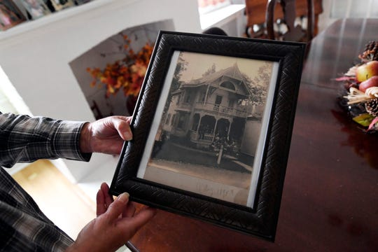 Ruth Blazure's daughter Jacque Corcoran holds an old photo of her mother's home on St. John's Avenue, which can be seen on the 25th annual Mount Tabor house tour this Saturday, September 29, 2018.