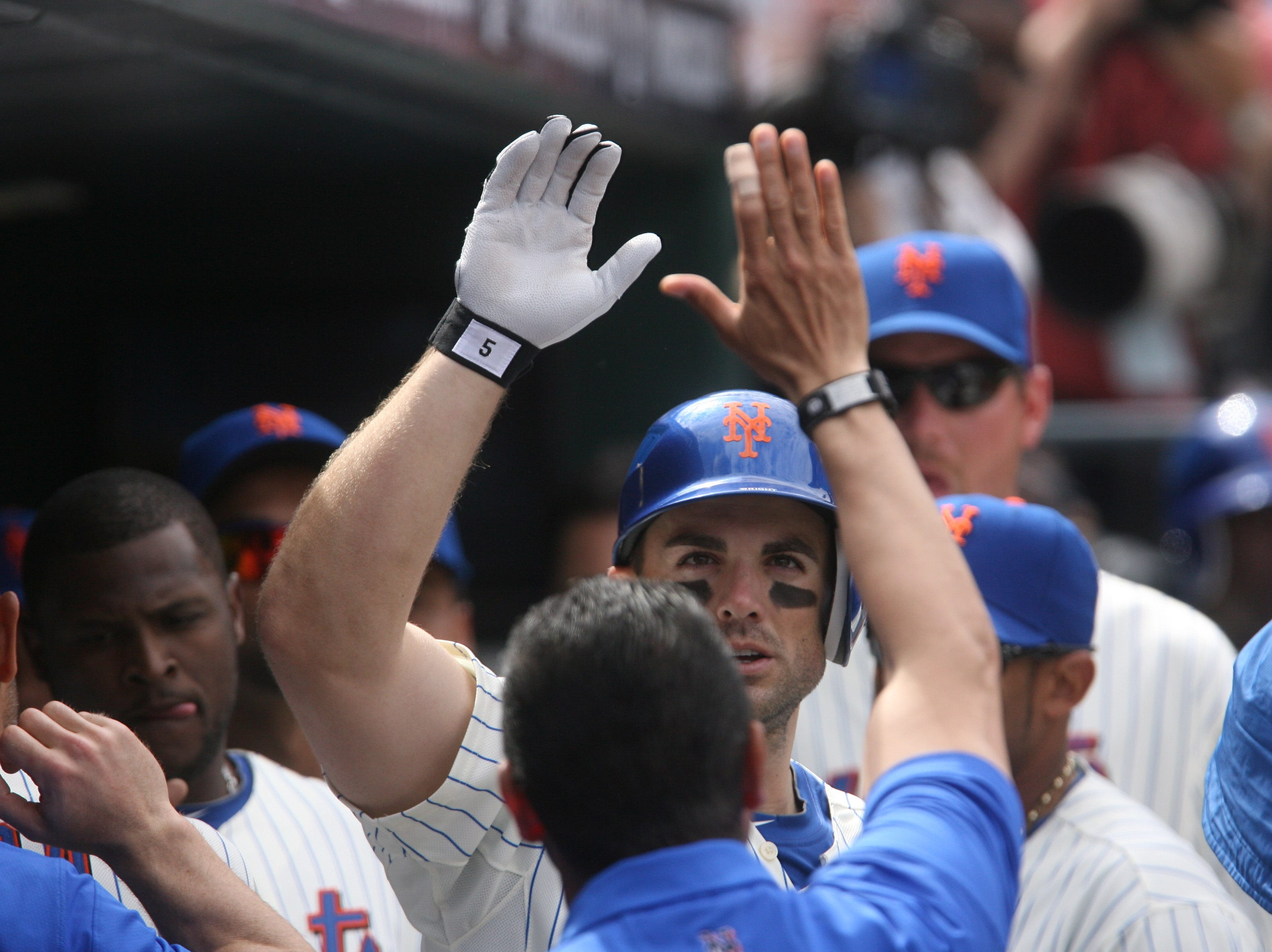 David Wright is greeted in the dug out after hitting a two run HR in the first inning. --  CHRIS PEDOTA / STAFF PHOTOGRAPHER
