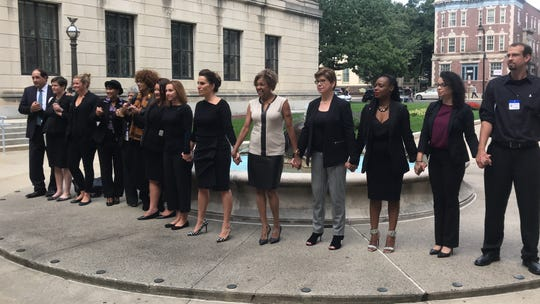 Democratic lawmakers stand with other participants in a national #BelieveSurvivors walkout outside the Statehouse in Trenton on Sept. 24, 2018.