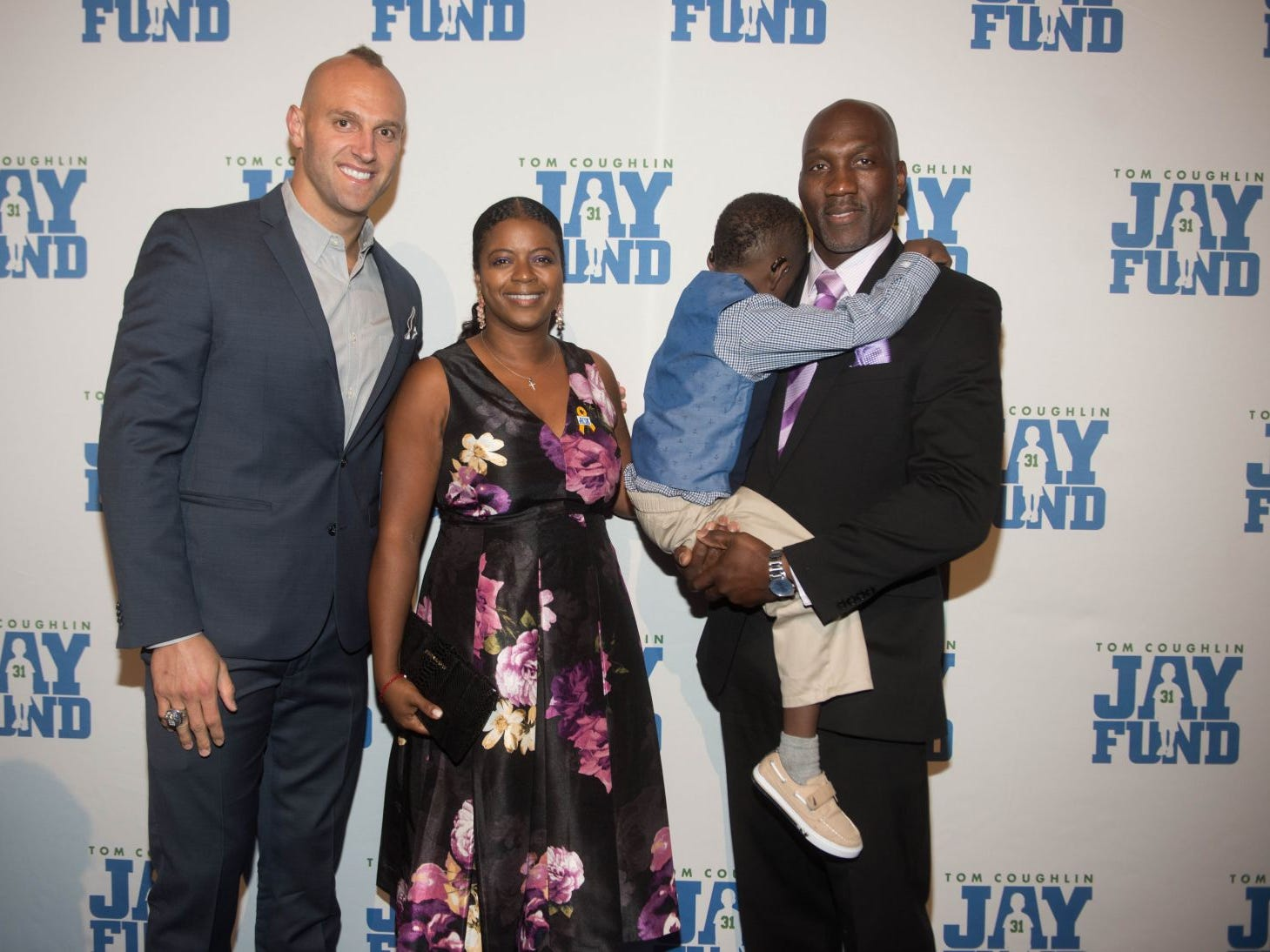Mark Herzlich, Kesha Davis, Cameron and Reggie Davis. The 14th annual Jay Fund Champions for Children Gala was held at Cipriani 42nd Street. 09/21/2018