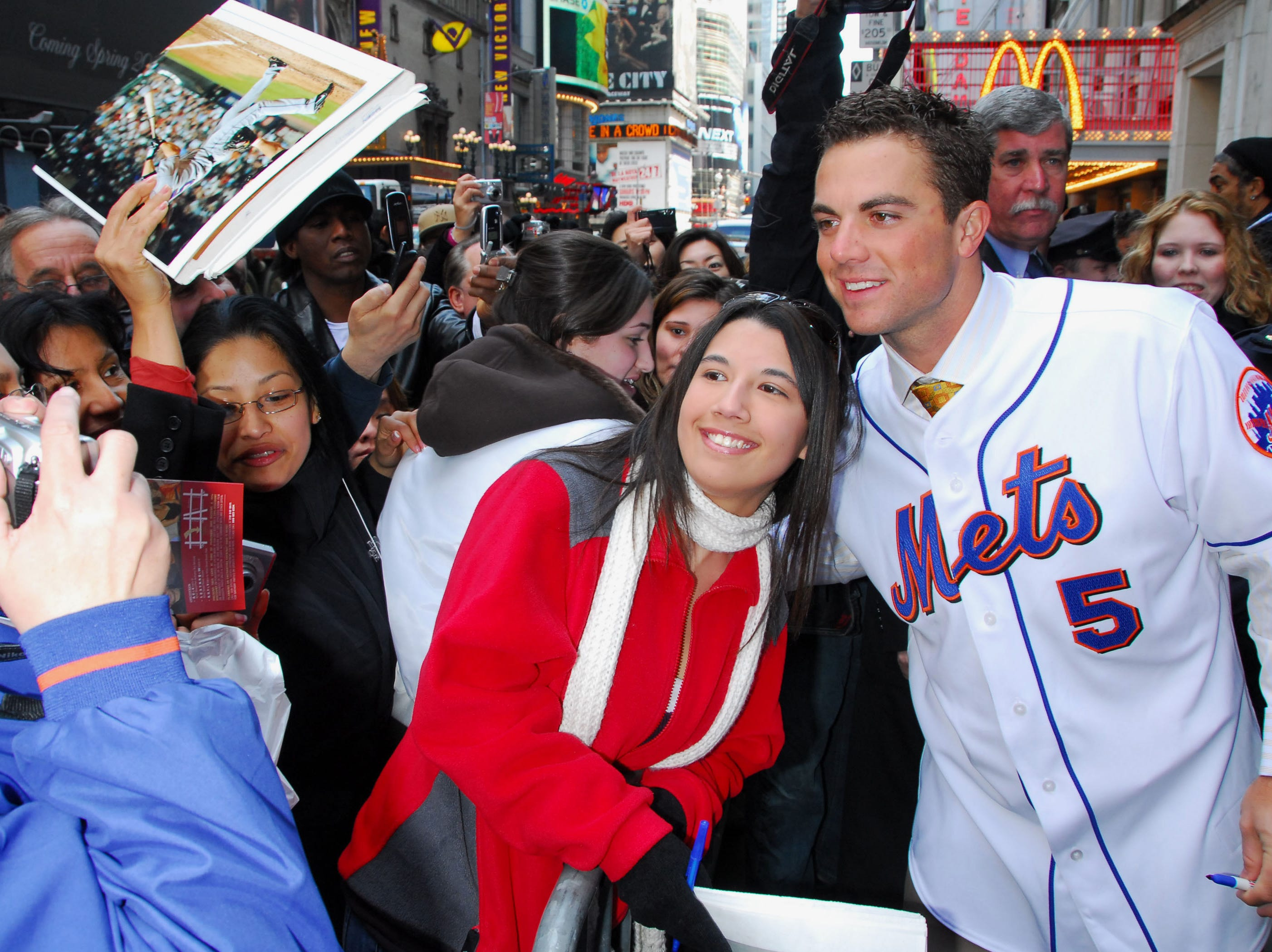 In this photo released by Madame Tussauds in New York, Mets third baseman David Wright, right, has his photo taken with a fan outside Madame Tussauds in New York, Tuesday, April 10, 2007. Wright was on hand for the unveiling of his wax likeness at the museum. (AP Photo/Madame Tassauds, Alex Oliveria) **NO SALES**