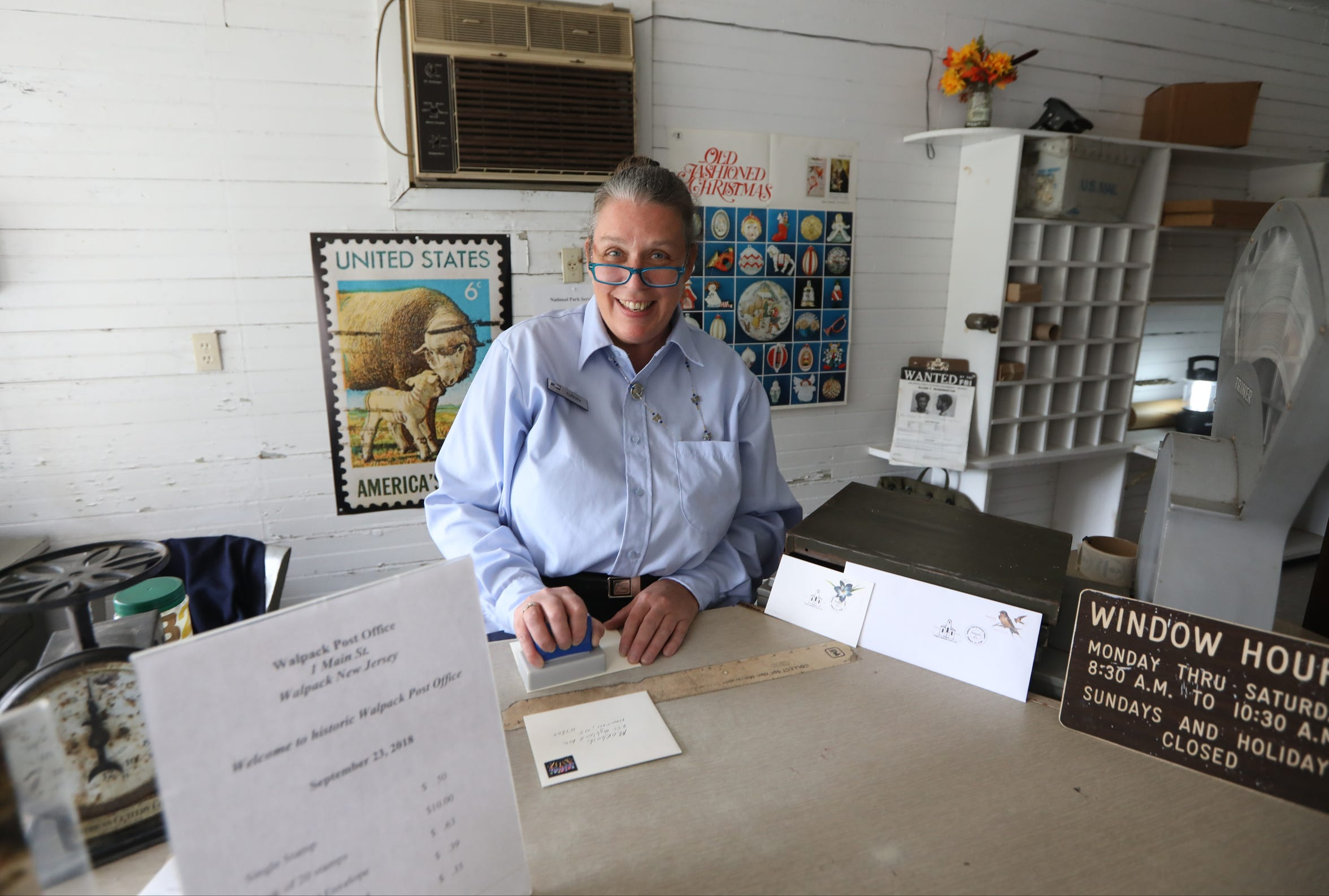 Cathy Rush, who was postmaster of the Walpack post office, and the last official clerk when they closed in 1987, resumed her position for one day to stamp postmarks for Walpack Remembrance Day, Sunday, September 23, 2018.