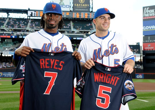 Mets Jose Reyes, left, and David Wright show off their All-Star jerseys before their baseball game against the Atlanta Braves at Citi Field in New York, Friday, July 9, 2010. Wright will be the starting third baseman and Reyes the backup shortstop.