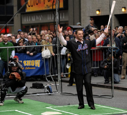 """In this photo provided by CBS, New York Mets' David Wright hits baseballs pitched by """"Late Show with David Letterman"""" host David Letterman on 53rd Street outside the Ed Sullivan Theater in New York during a taping of the """"Late Show with David Letterman"""" on Monday April 14, 2008. (AP Photo/CBS, Jeffrey R. Staab) ** NO SALES, FOR NORTH AMERICAN USE ONLY**"""