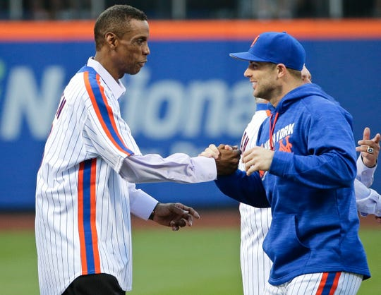 Mets' David Wright, right, greets Dwight Gooden, before a baseball game between the Los Angeles Dodgers and the New York Mets, Saturday, May 28, 2016, in New York.