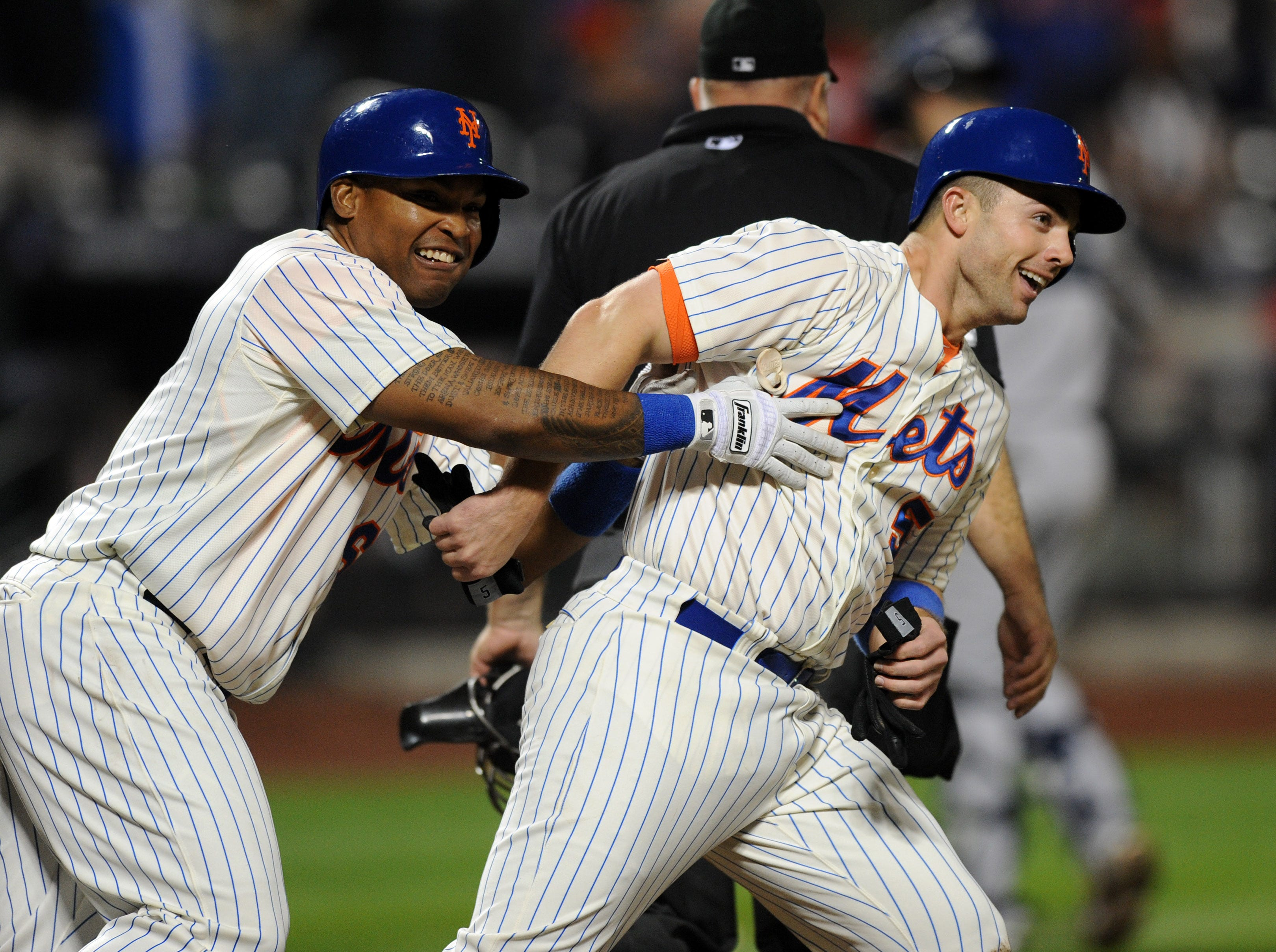 2013: New York Mets David Wright is congratulated by teammates after scoring the winning run of Tuesday's interleague game against the New York Yankees.
