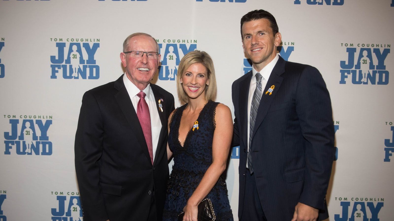 Tom Coughlin, Kate Snee and Chris Snee. The 14th...