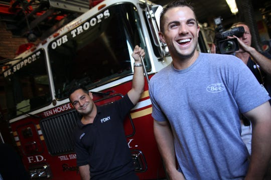 2010: David Wright of the Mets talks with Sal Cotrona, left and other fire fighters from Ladder 10, Engine 10 (or the 10 house) during a visit to the fire house in lower Manhattan Friday afternoon.   LESLIE BARBARO/STAFF PHOTOGRAPHER