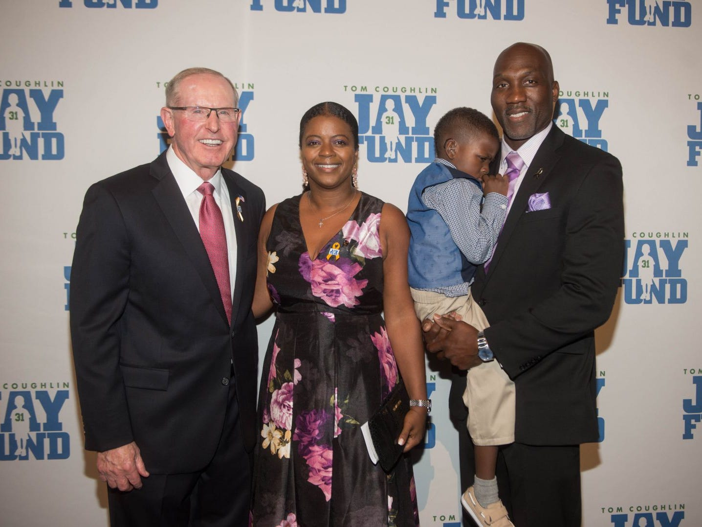 Tom Coughlin, Kesha Davis, Cameron and Reggie Davis. The 14th annual Jay Fund Champions for Children Gala was held at Cipriani 42nd Street. 09/21/2018