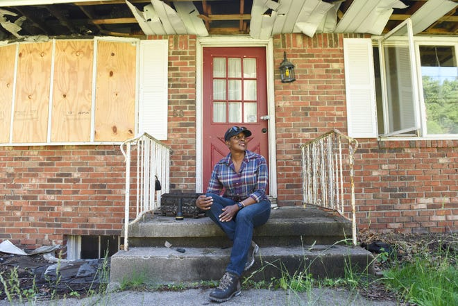Betty Adams sits on the front steps of her boarded up home on the morning it was to be demolished on June 14, 2018. Her home in Hawthorne caught fire the morning of Sept. 27, 2017.