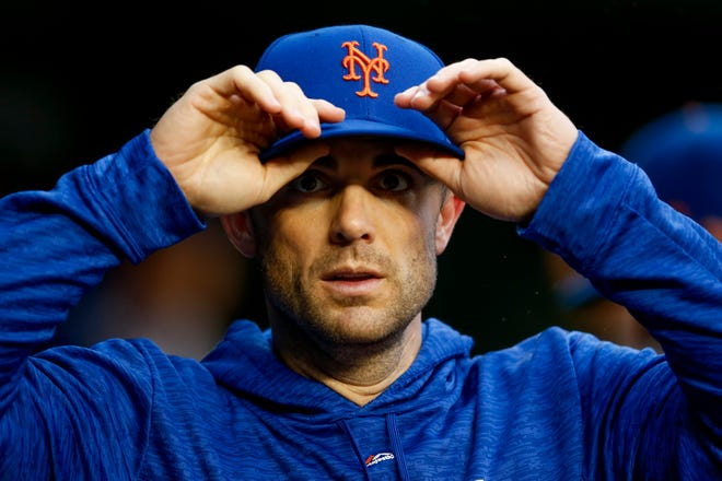 Mets' David Wright walks through the dugout during a baseball game against the Washington Nationals at Nationals Park, Sunday, Sept. 23, 2018, in Washington. Wright has not played for the Mets since May 2016 because of neck, back and shoulder injuries.