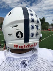 Paramus, Mahwah and River Dell are each wearing No. 4 stickers on the back of their football helmets in memory of former Ramsey HS athletic director Jim Grasso.