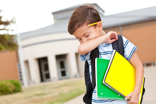 Tell your kids to cough into their elbows to help prevent the spread of germs.