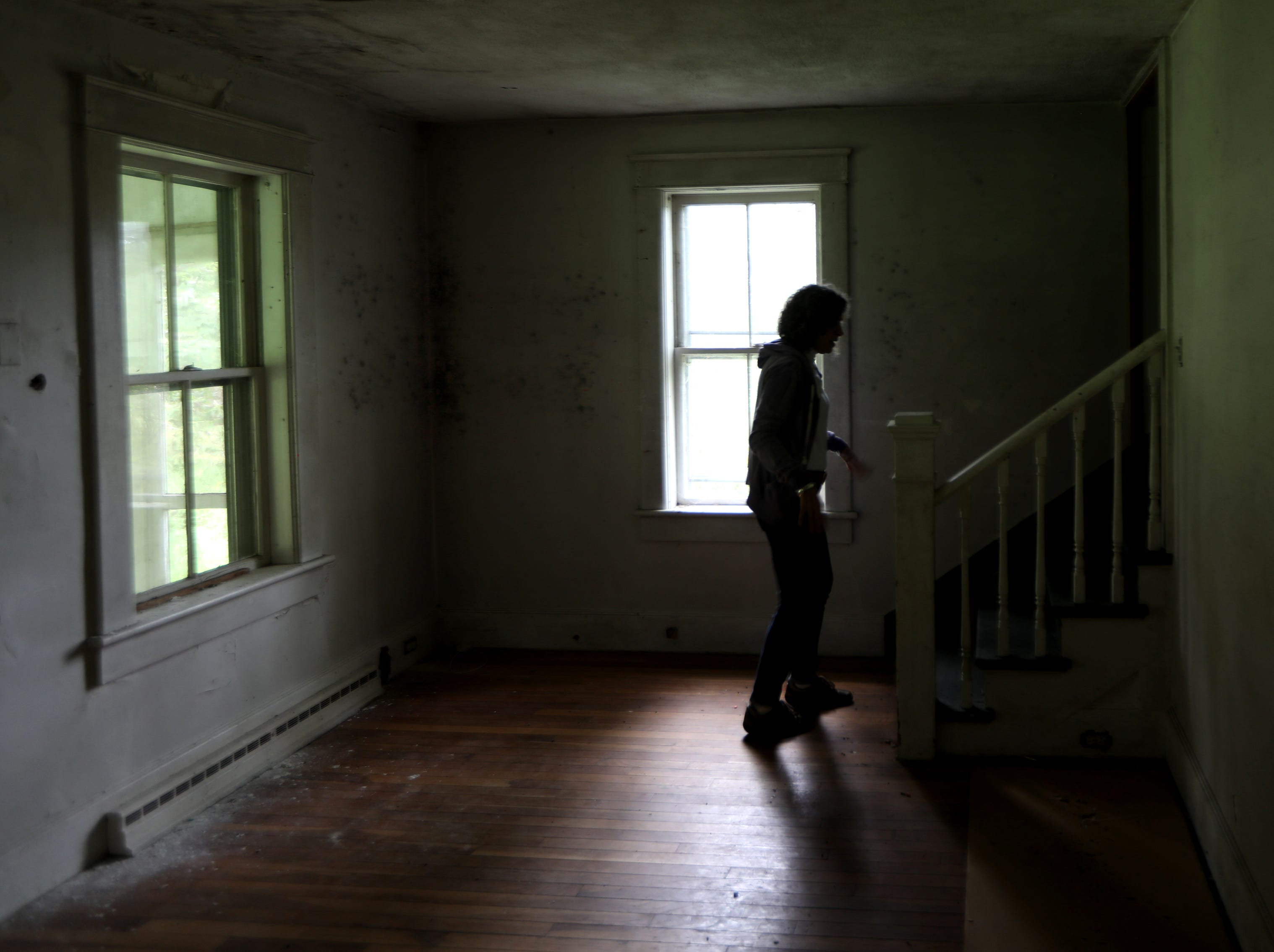 Rosemarie Briegel, 62, currently of Sandyston, is shown in the Walpack home where she lived for the majority of her first 20 years. Sunday, September 23, 2018