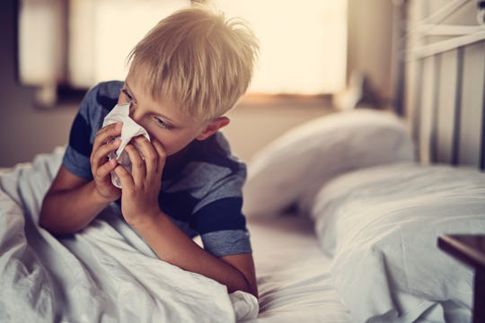 Seasonal allergies can make kids miserable, but they're not contagious.