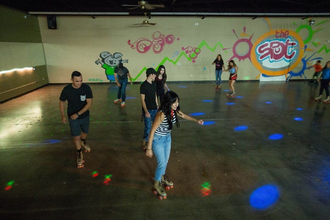 Visitors to The Spot Family Entertainment Center skate around the rink on Friday, Sept. 21.