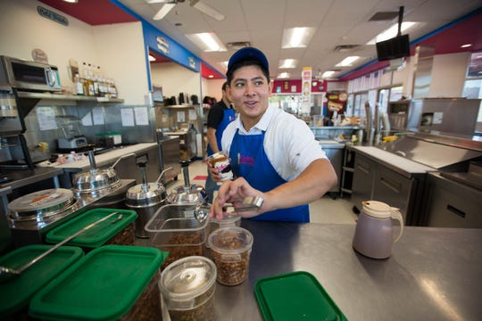 Rome Silva constructs a Gizmo Salted custard for a customer on Monday, Sept. 24, 2018, at Caliche's Frozen Custard's Roadrunner Parkway location in Las Cruces.