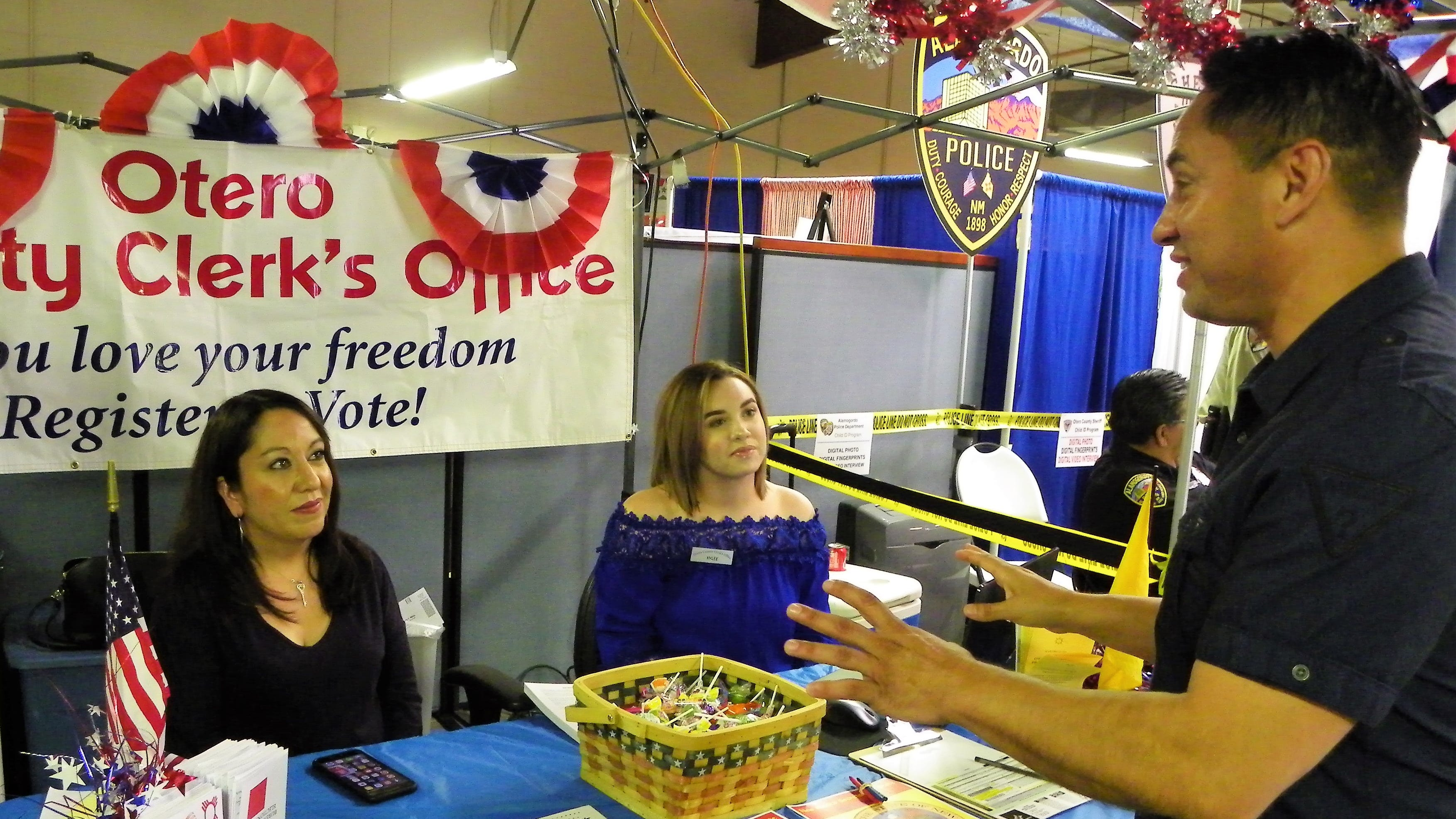Lieutenant Governor candidate Howie Morales chats with representatives from the Otero County Fair Saturday.