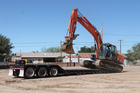 Heavy equipment operator Cory Gorby drives his excavator onto a trailer to be hauled away following the successful demolition of the Sahara Apartment complex last week.
