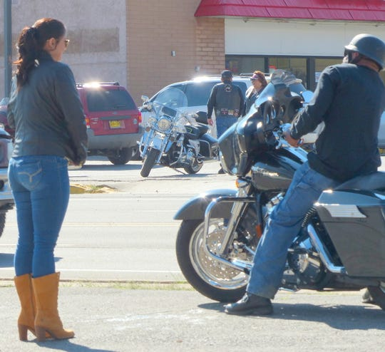 The crowd began assembling along Sudderth to watch the informal parade of motorcycles drive by Saturday morning.