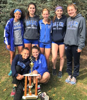 The Salem girls cross country team is all smiles after winning the Jackson Invitational.