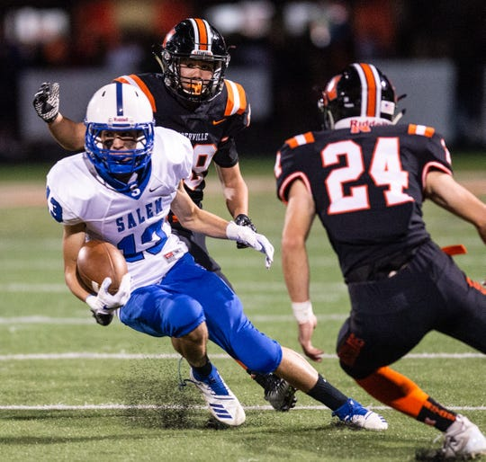 Salem's Blake Donoher (left) makes the cut to elude Northville tackler Spencer Ziparo in Friday's KLAA West clash.