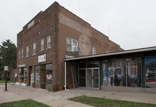 A developer had a vision for retail shops and residences on the old Saxton's property at the corner of Ann Arbor Trail and Deer Street.