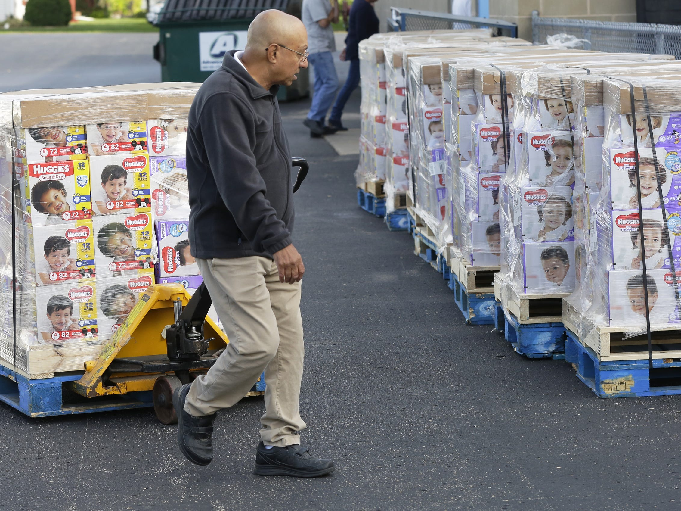 Hussain Sattar of Father Carr's Place 2B helps move pallets of diapers Monday, Sept. 24, 2018, at the Oshkosh Area Community Food Pantry. USA TODAY NETWORK-Wisconsin and Kimberly-Clark Corp. donated 100,400 diapers to nine food pantries in the area.