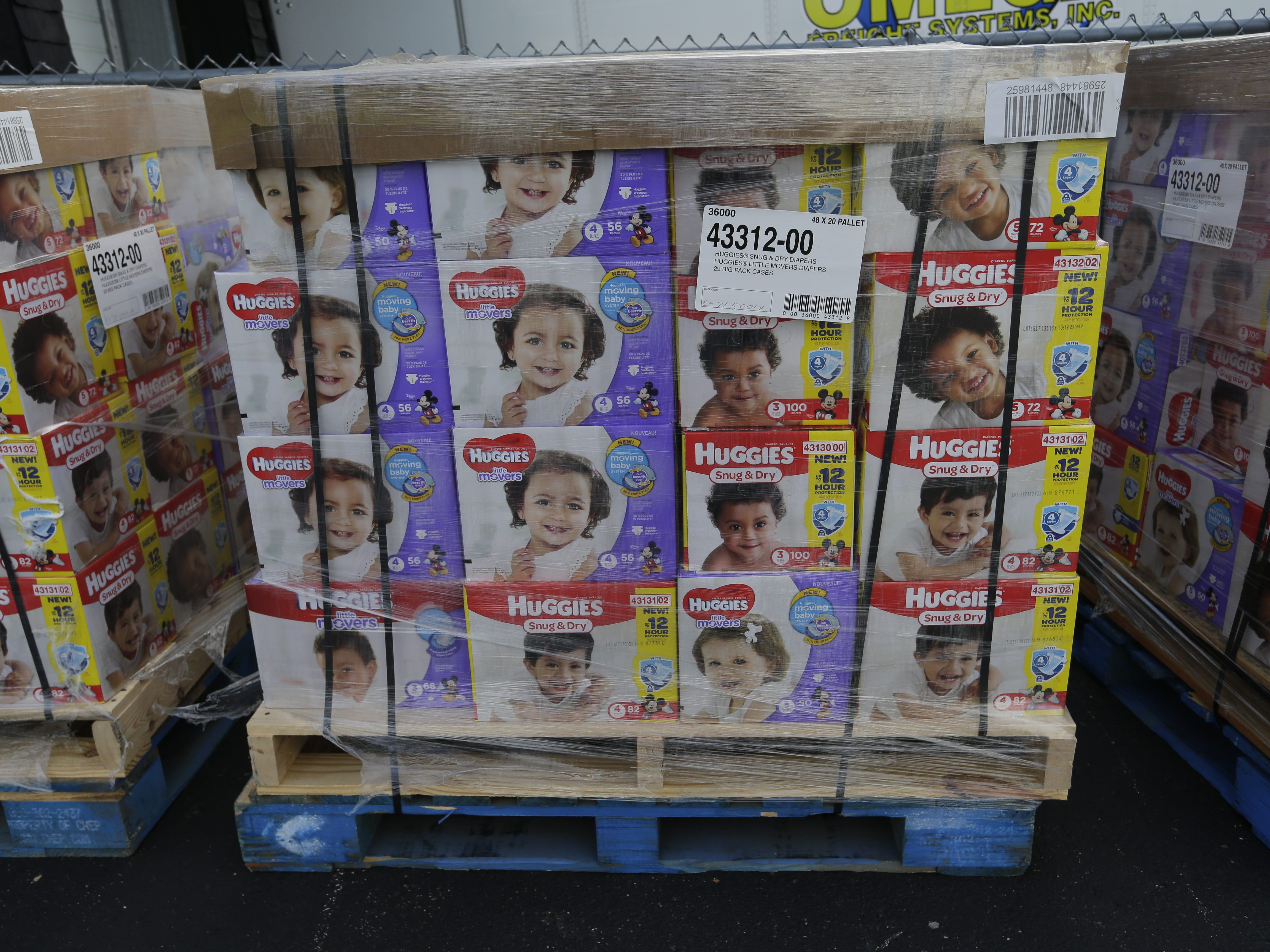 The Oshkosh Area Community Food Pantry gets a donation of 50 pallets with 100,400 diapers on them from USA TODAY NETWORK-Wisconsin and Kimberly-Clark Corp. on Monday, Sept. 24, 2018, in Oshkosh. The diapers will go to nine food pantries in the area.