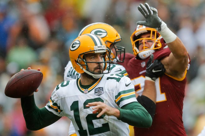 Green Bay Packers quarterback Aaron Rodgers (12) prepares to pass the ball during the first half of an NFL football game against the Washington Redskins, Sunday, Sept. 23, 2018, in Landover, Md. (AP Photo/Carolyn Kaster) ORG XMIT: FDX120