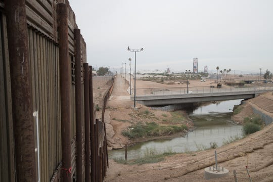 The New River flows across the border from Mexicali into Calexico, Calif.
