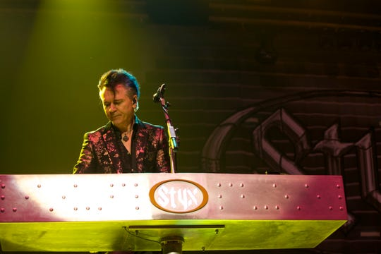 Lawrence Gowan plays keyboards and shares lead vocal duties for Styx.
