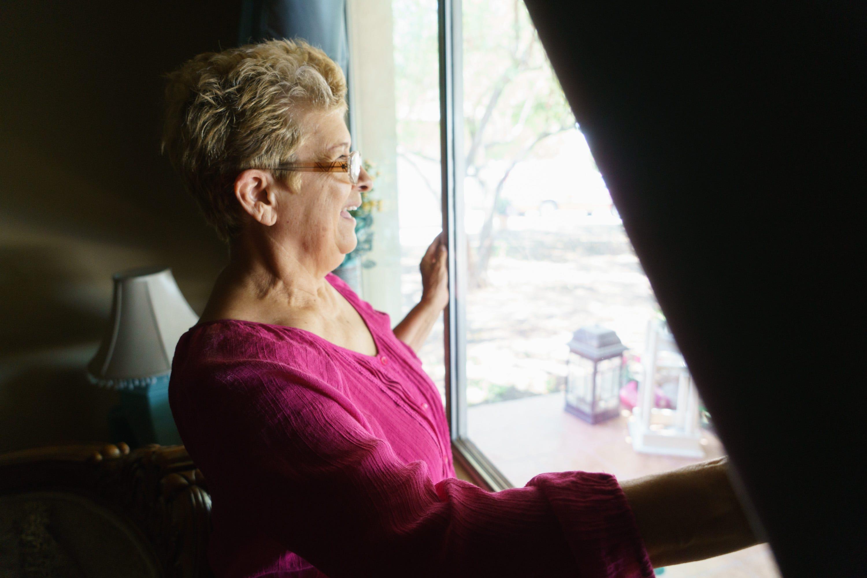 At her home in Calexico, Ernestina Calderón looks outside at her grandchildren.