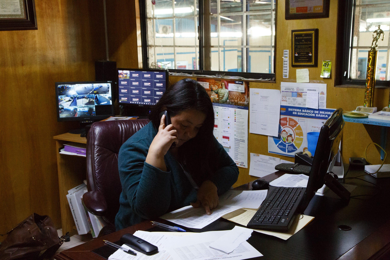 Diana Gabriela Arangure works in her office at Leonardo da Vinci Integral School in Mexicali.