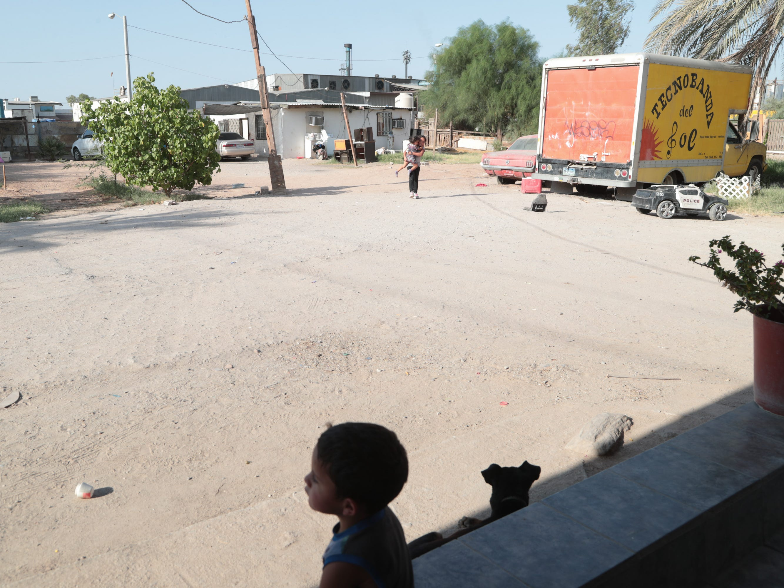 Children play outside their home near the Industrias Zahori factory in Mexicali.