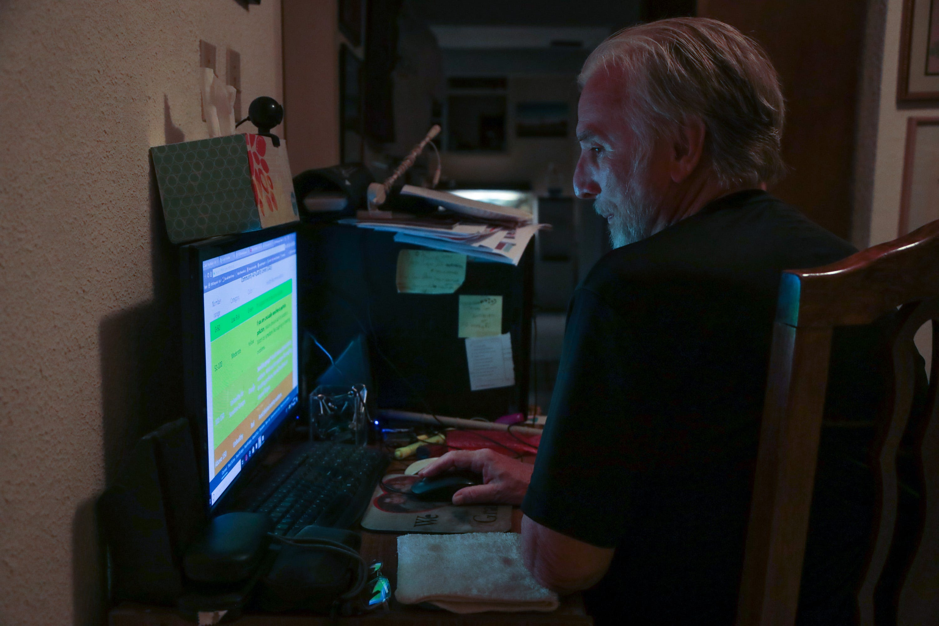 Ray Askins, an environmental activist, checks the readings of an air monitor at his home in Mexicali on Sept. 19, 2018. The monitor is installed on his roof.