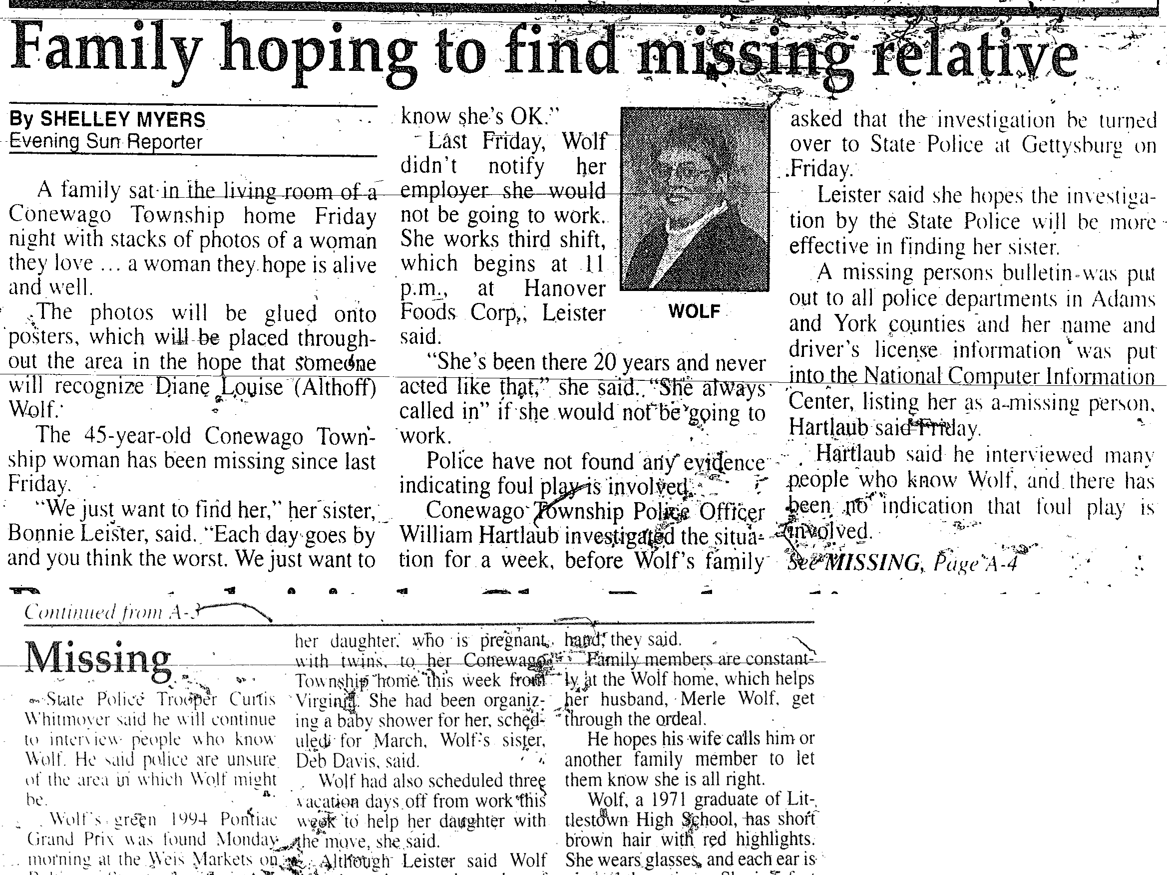 An Evening Sun newspaper clipping from February 1999 details Wolf's disappearance.