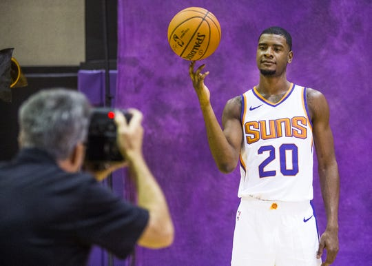 Josh Jackson, forward for the Phoenix Suns,  poses for photographer Rob Schumacher at Phoenix Suns Media Day at Talking Stick Resort Arena in Phoenix, Monday, September 24, 2018.